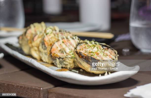close-up of food in plate on table at restaurant - kingston jamaica stock pictures, royalty-free photos & images