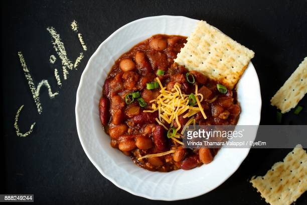 close-up of food in plate on table - chili stock photos and pictures