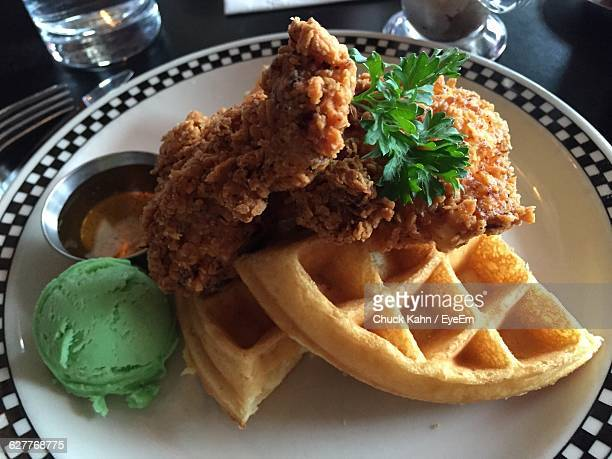 close-up of food in plate - chicken and waffles stock photos and pictures