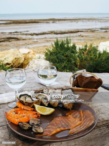 close-up of food on table at beach - calvados stock pictures, royalty-free photos & images