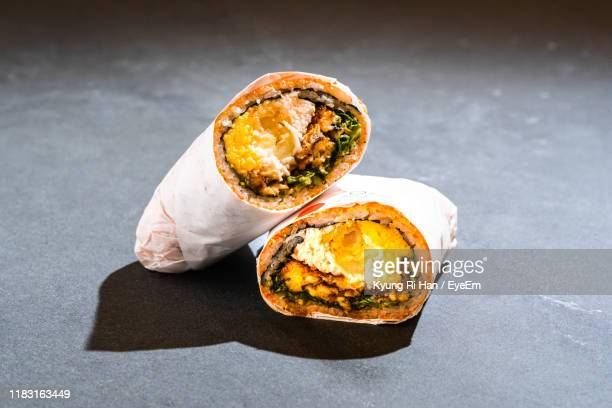 close-up of food on table - burrito stock pictures, royalty-free photos & images