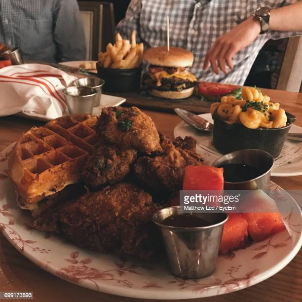 close-up of food on table - chicken and waffles stock photos and pictures