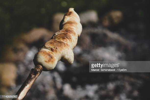 close-up of food on wooden stick - stick stock-fotos und bilder