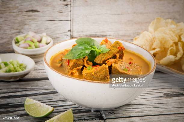 close-up of food served in bowl on wooden table - curry stock pictures, royalty-free photos & images