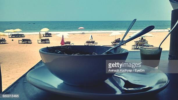 Close-Up Of Food Served On Table At Beach Against Sky