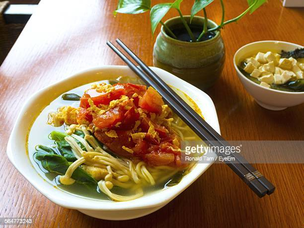 Close-Up Of Food With Chopsticks On Table
