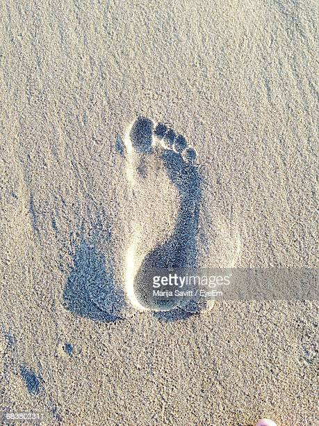 Close-Up Of Footprint In Sand At Beach