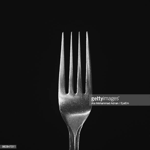 close-up of fork against black background - forchetta foto e immagini stock
