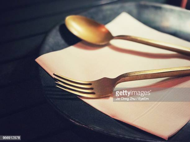 close-up of fork and spoon and tissue in plate - utensil stock pictures, royalty-free photos & images