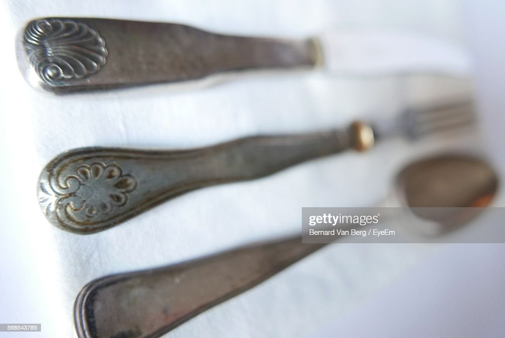 Close-Up Of Fork With Spoon And Knife On Table : Stock Photo