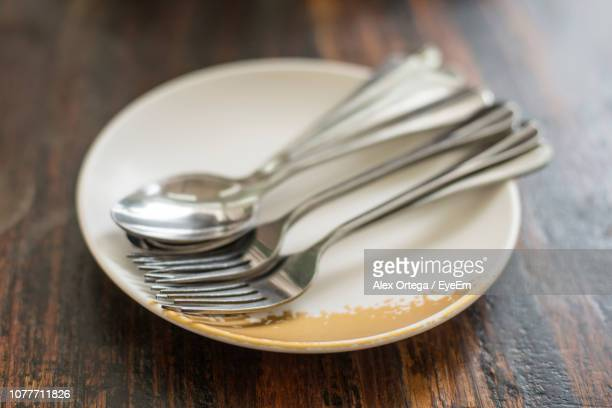Close-Up Of Forks And Spoons On Table
