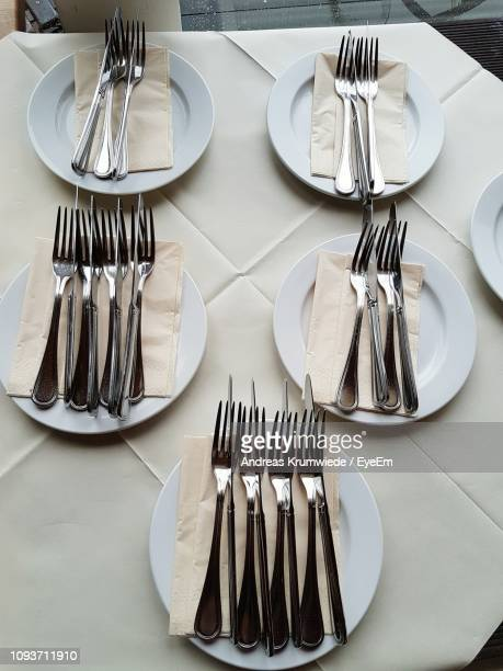 Close-Up Of Forks In Plate On Table