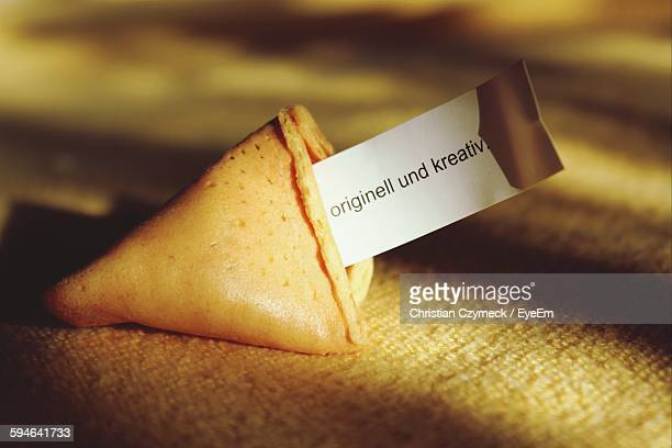 Close-Up Of Fortune Cookie On Table