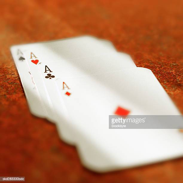 Close-up of four ace cards