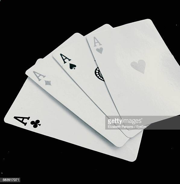 Close-Up Of Four Aces On Black Background