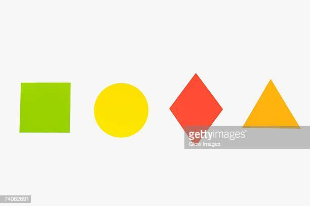 Close-up of four different geometric shapes