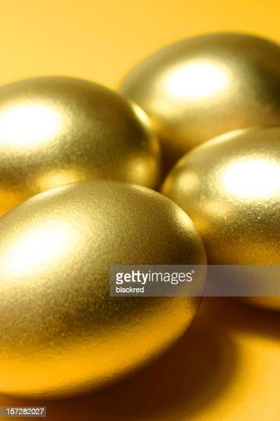 Close-up of Four Golden Eggs