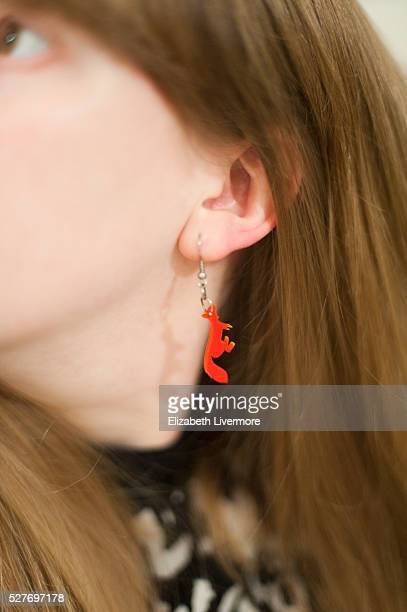 Close-up of fox earring