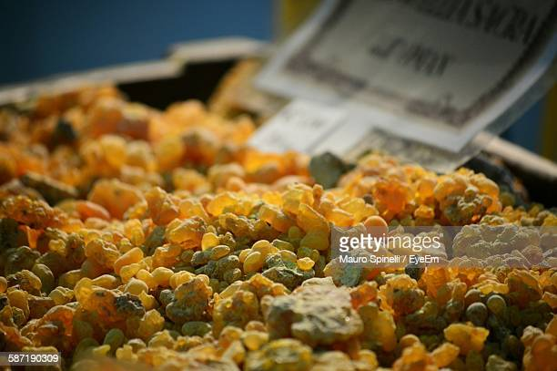 Close-Up Of Frankincense Heap With Label At Market Stall