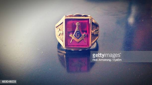 close-up of freemasons ring on table - freemasons stock pictures, royalty-free photos & images