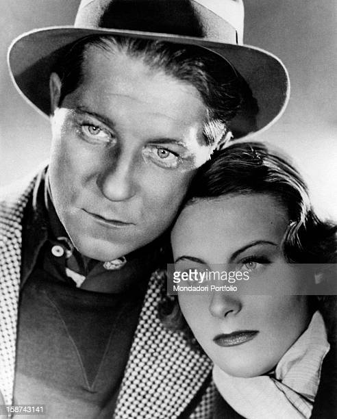 Close-up of French actors Jean Gabin and Michéle Morgan in the film Le Quai des Brumes. France, 1938
