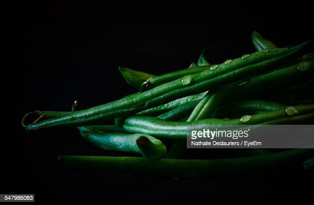 Close-Up Of French Beans Over Black Background