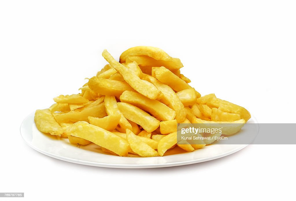 Close-Up Of French Fries In Plate Over White Background : Stock Photo