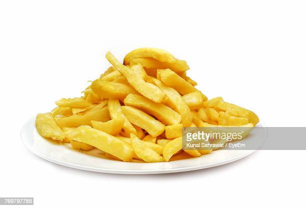 close-up of french fries in plate over white background - fries imagens e fotografias de stock