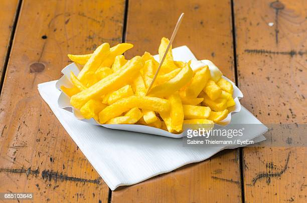 close-up of french fries on a paper plate with toothpick - paper napkin stock photos and pictures