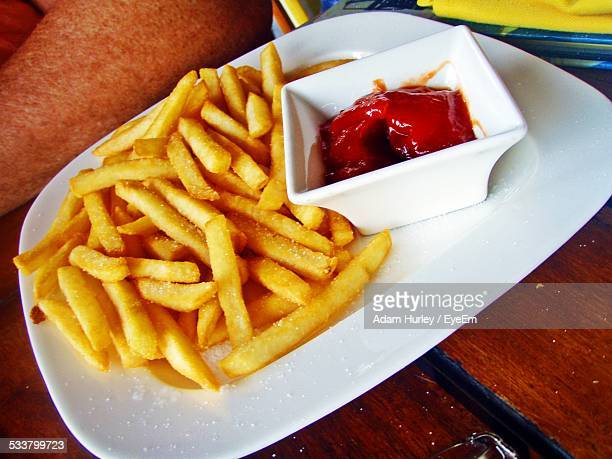 close-up of french fries with ketchup - fast food french fries stock photos and pictures