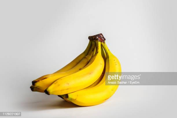 Close-Up Of Fresh Bananas Against White Background