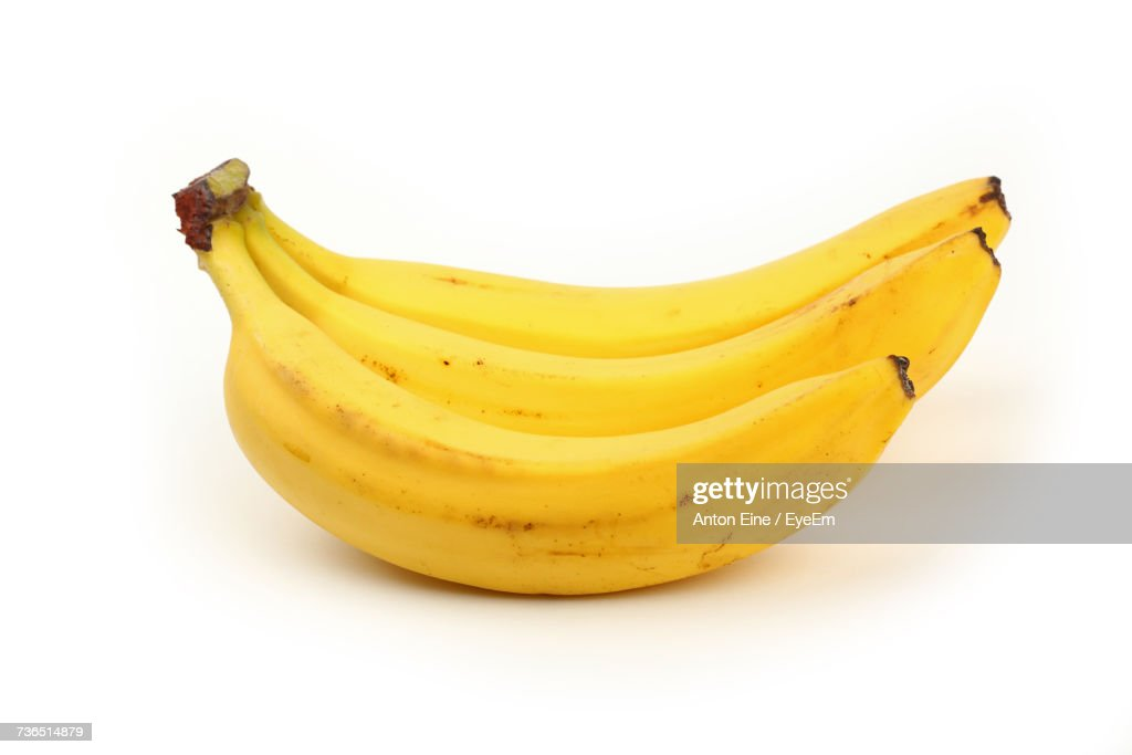 Close-Up Of Fresh Bananas On White Background : Stock Photo