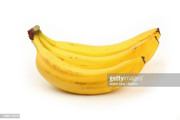 Close-Up Of Fresh Bananas On White Background