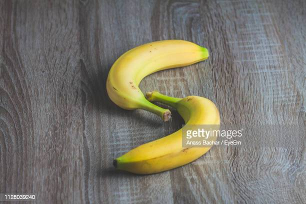 Close-Up Of Fresh Bananas On Wooden Table