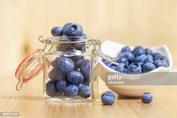 Close-Up Of Fresh Blueberries In Bowl and jar