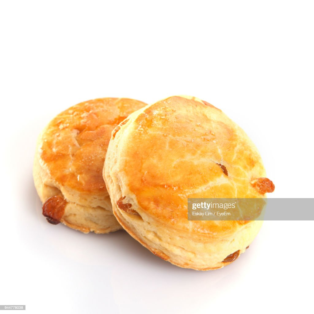 Close-Up Of Fresh Buns With Raisins Against White Background : Stock Photo
