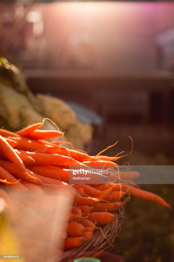 Close-up of fresh carrots on street market, Germany : Stock Photo