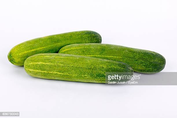 Close-Up Of Fresh Cucumber Against White Background