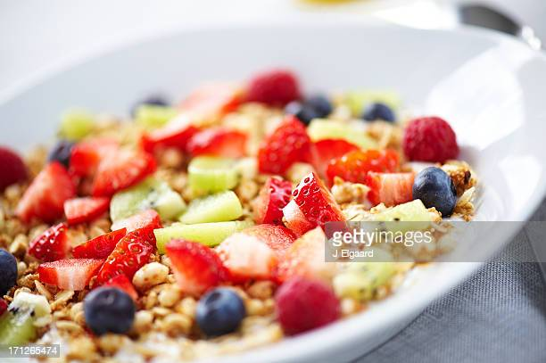 Closeup of fresh fruit on yougurt and muesli
