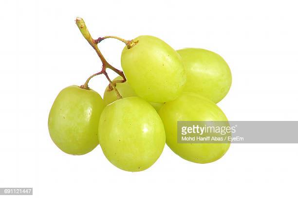 close-up of fresh grapes against white background - grape stock pictures, royalty-free photos & images