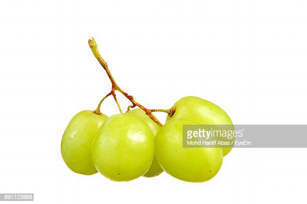 Close-Up Of Fresh Grapes Against White Background