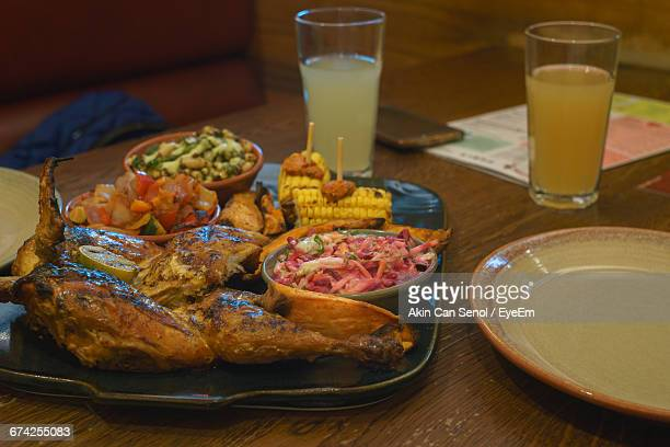 Close-Up Of Fresh Meal Served With Drinks On Table At Restaurant