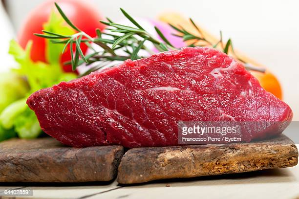 Close-Up Of Fresh Meat With Rosemary On Table