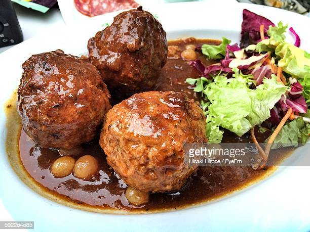 close-up of fresh meatballs with salad served in plate - liege stock pictures, royalty-free photos & images
