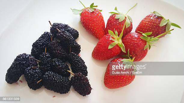 Close-Up Of Fresh Mulberries And Strawberries In White Plate