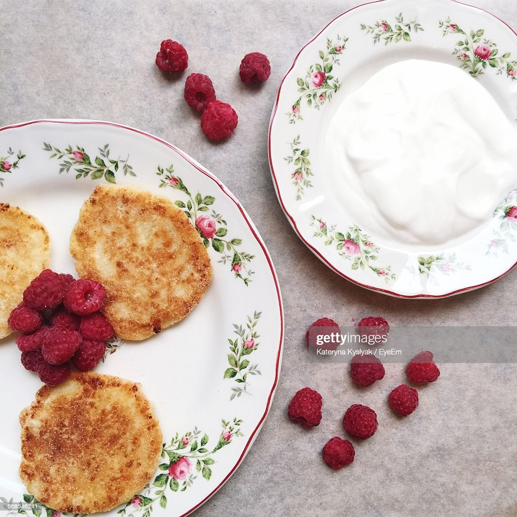 Close-Up Of Fresh Pancakes With Raspberries And Cream In Plate : Stock Photo