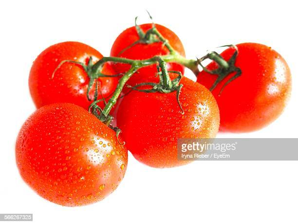 Close-Up Of Fresh Red Tomatoes Over White Background