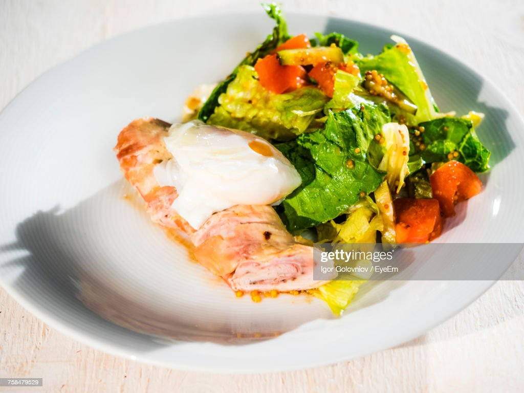 Close-Up Of Fresh Salad And Poached Egg In Plate : Stock Photo