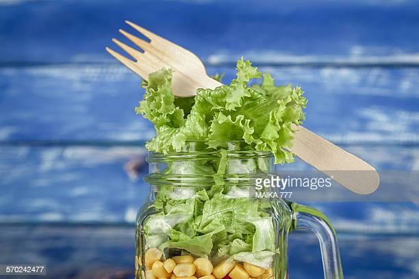 Close-up of fresh salad in a mason jar