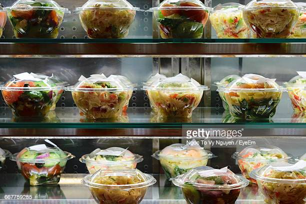 Close-Up Of Fresh Salads In Display Cabinet At Store